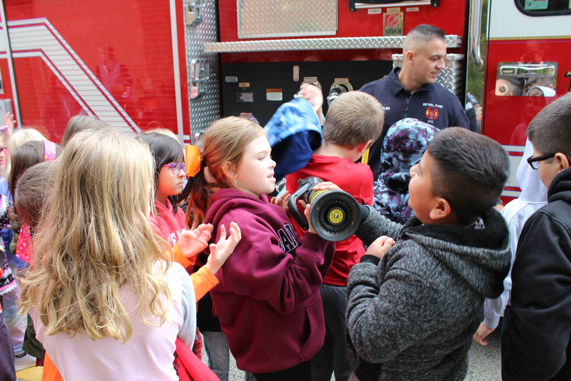 Students sharing fire equipment