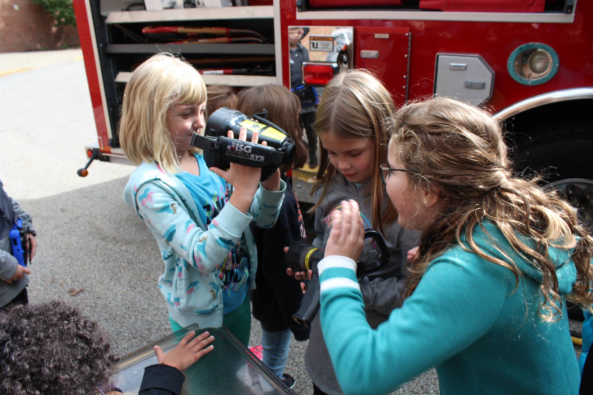 Students looking at fire fighting equipment
