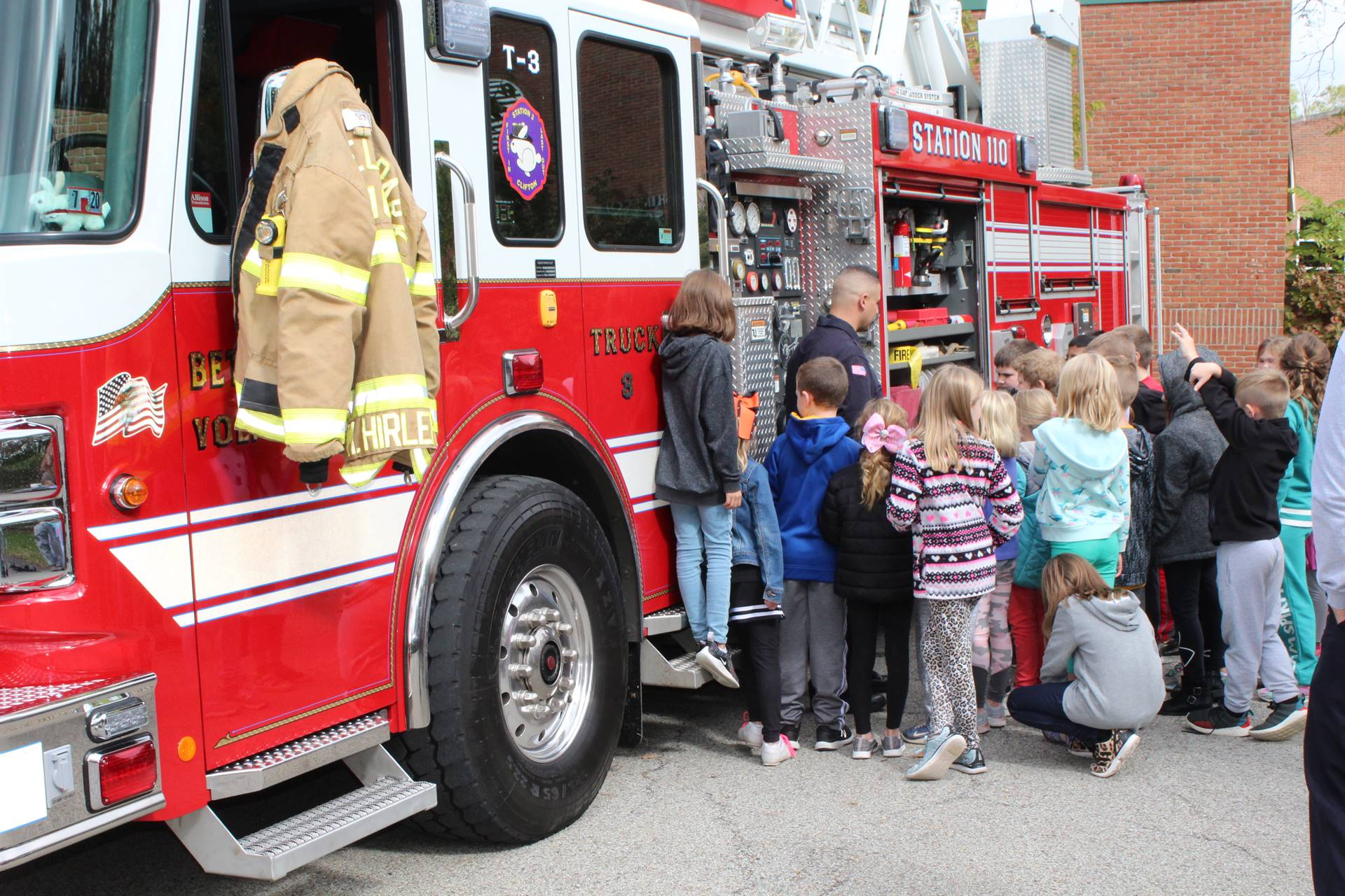 Students looking into a fire truck