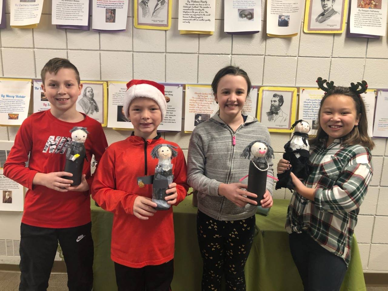 Four students with their recycled bottle creations