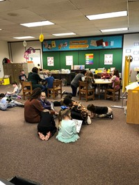 Students working together on the floor