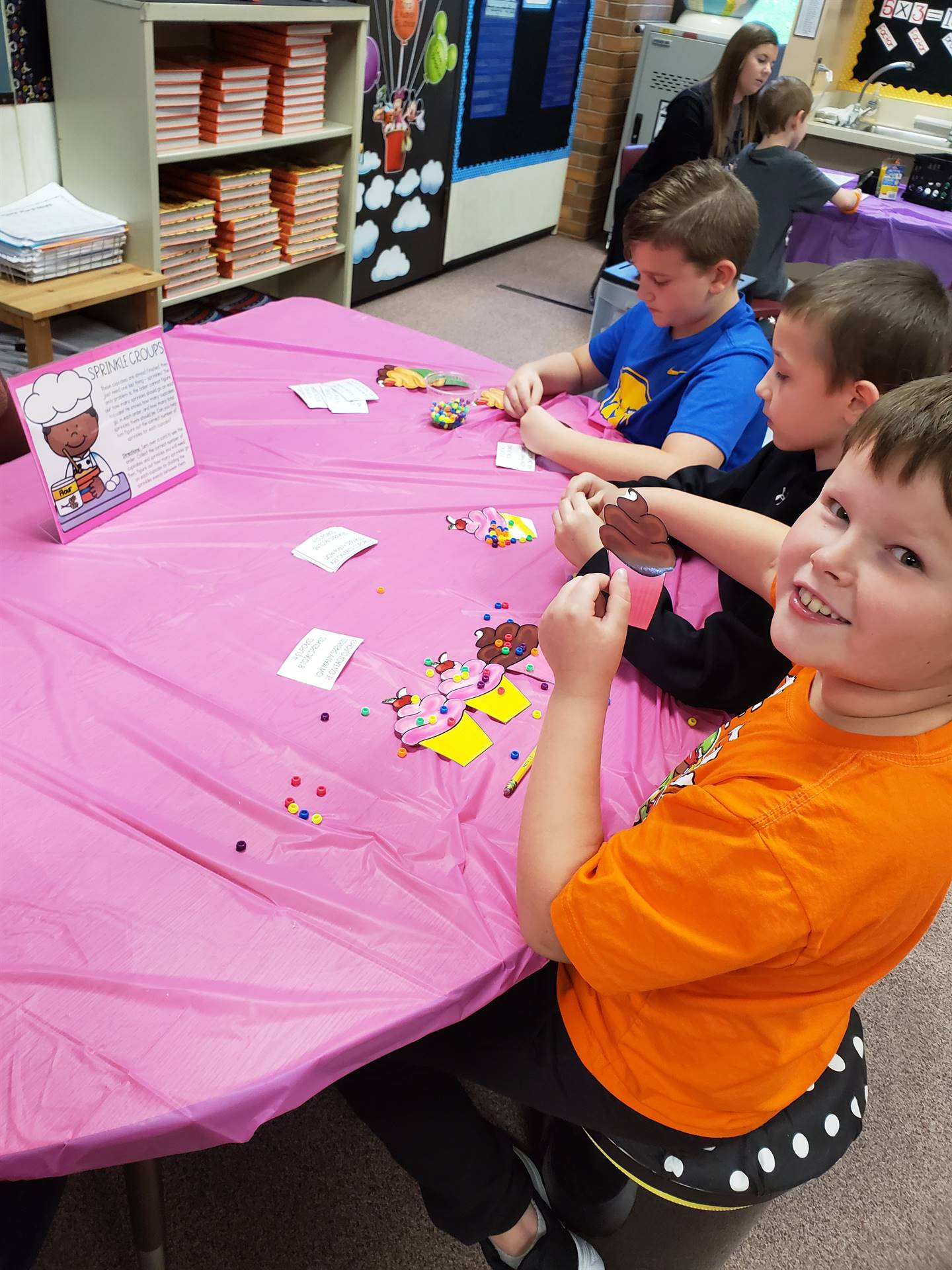 Students decorating paper cupcakes
