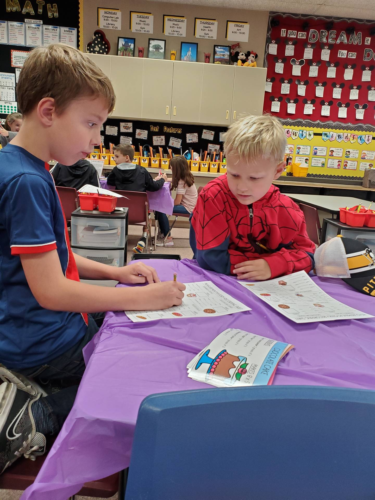 Two students doing worksheets