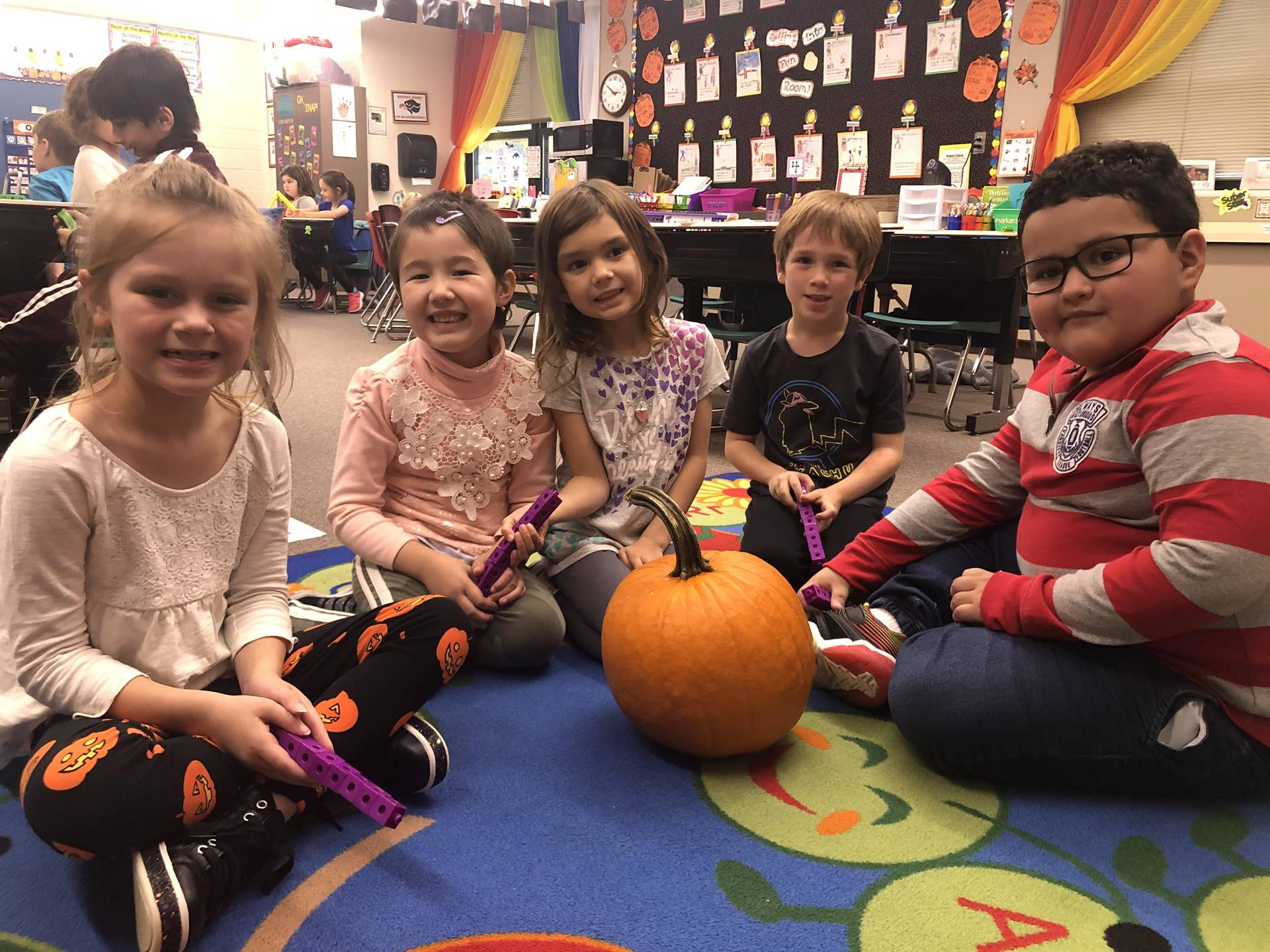Five students with a pumpkin