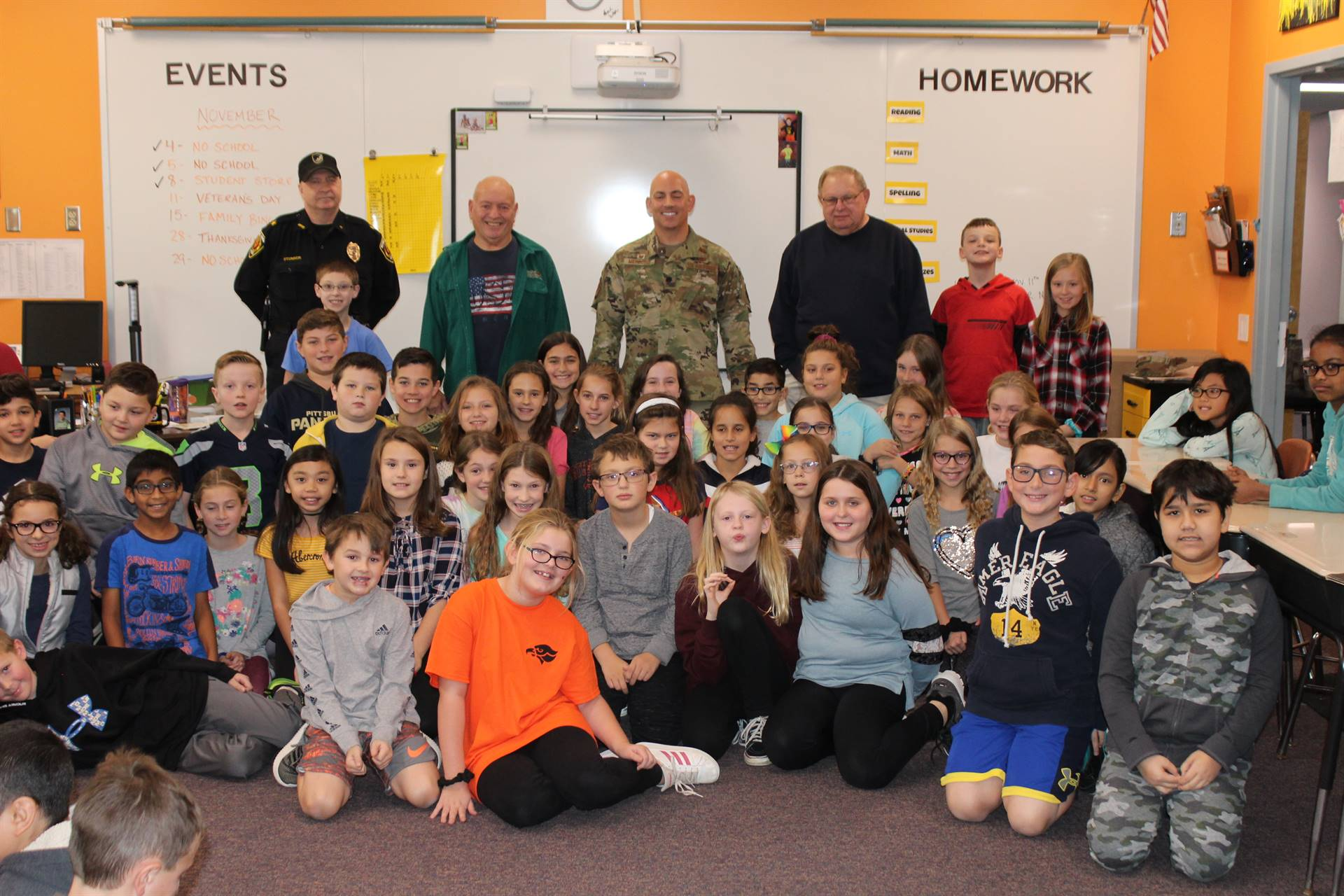 Group of students with four veterans