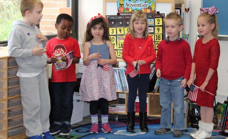 Six students reciting a patriotic poem