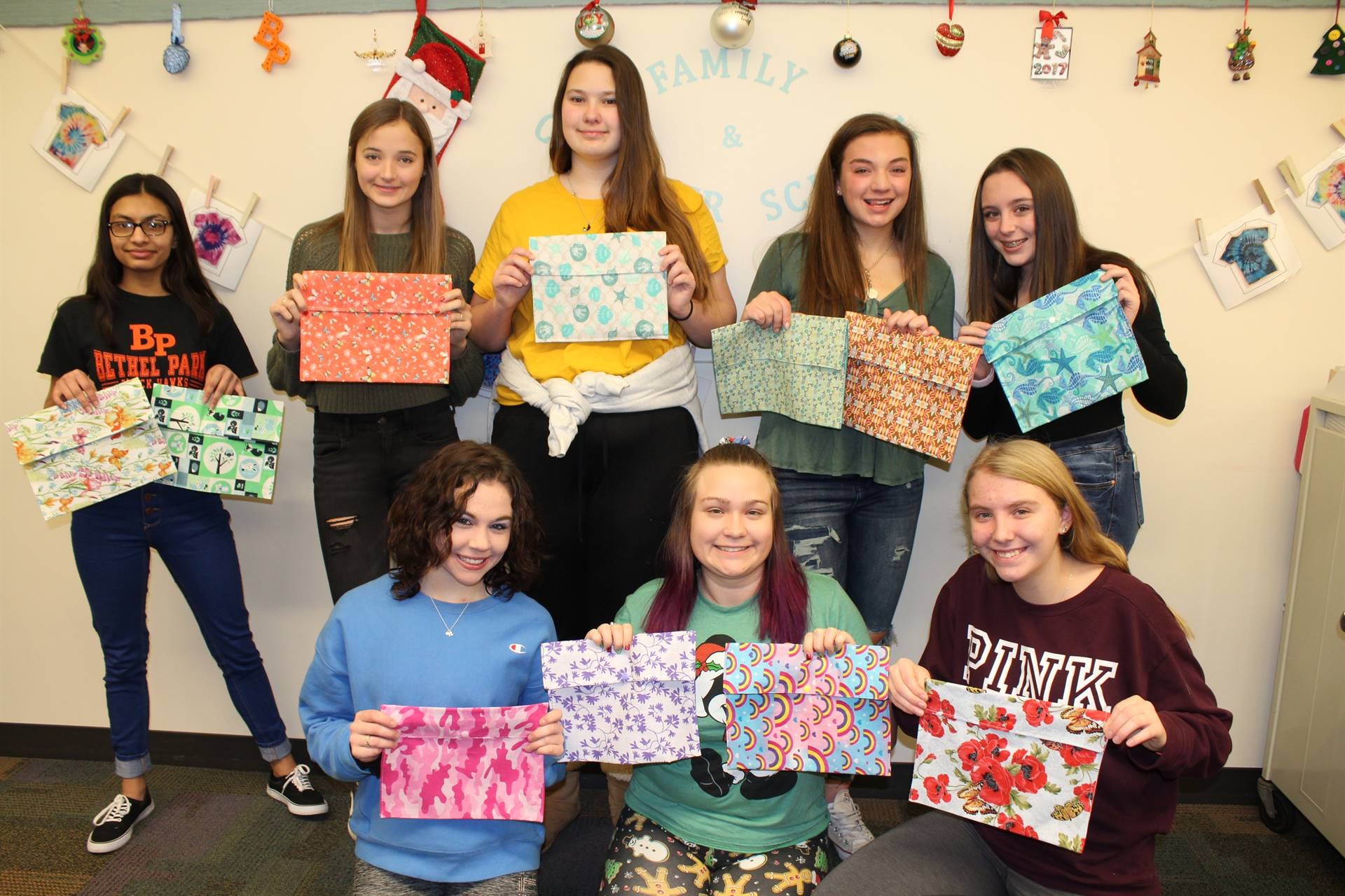 Eight Sewing students with their projects