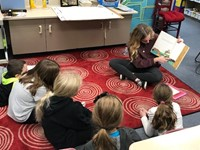 High School student reading to Lincoln students