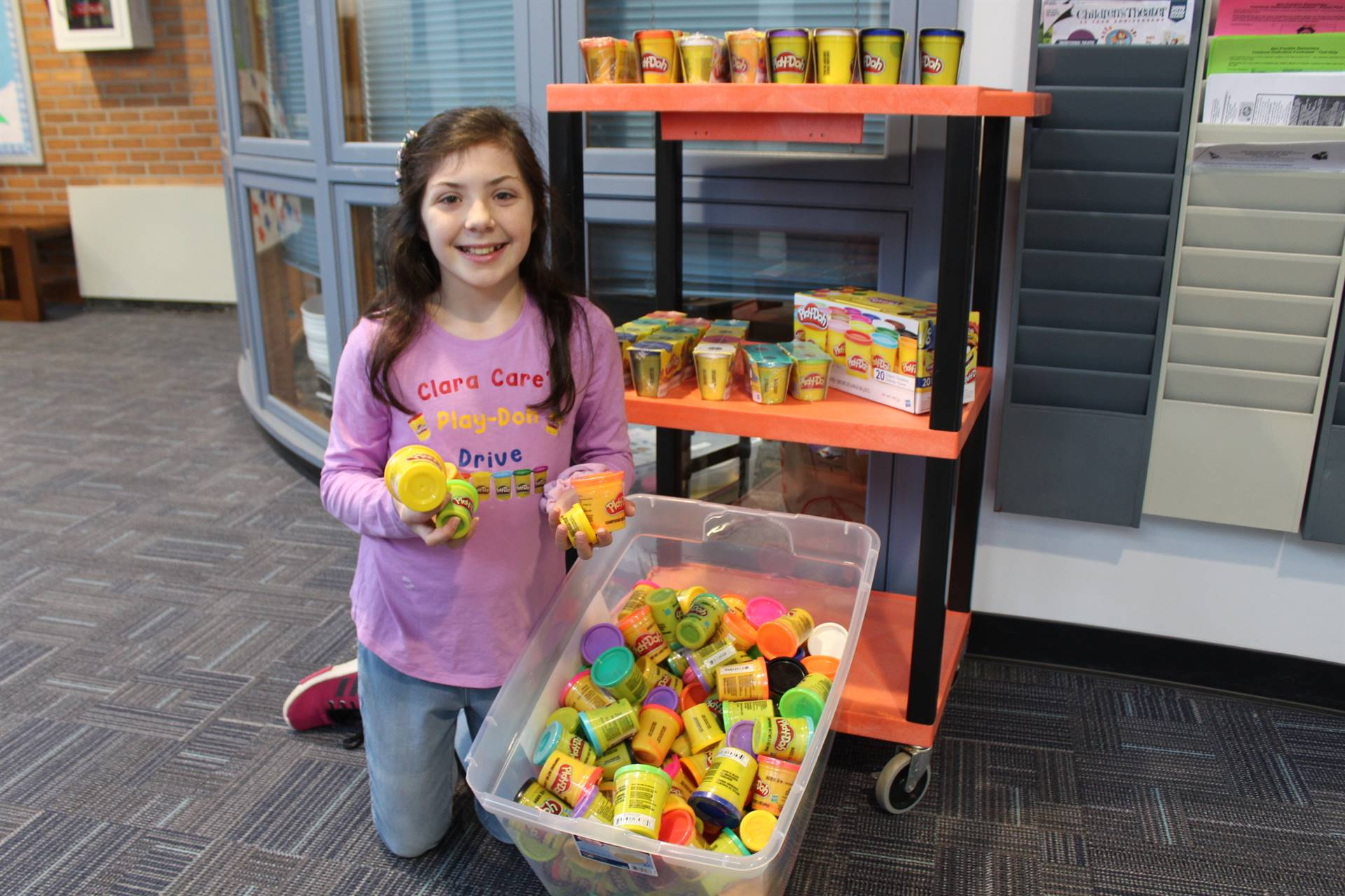 Student with some of the Play-Doh she collected for Children's Hospital