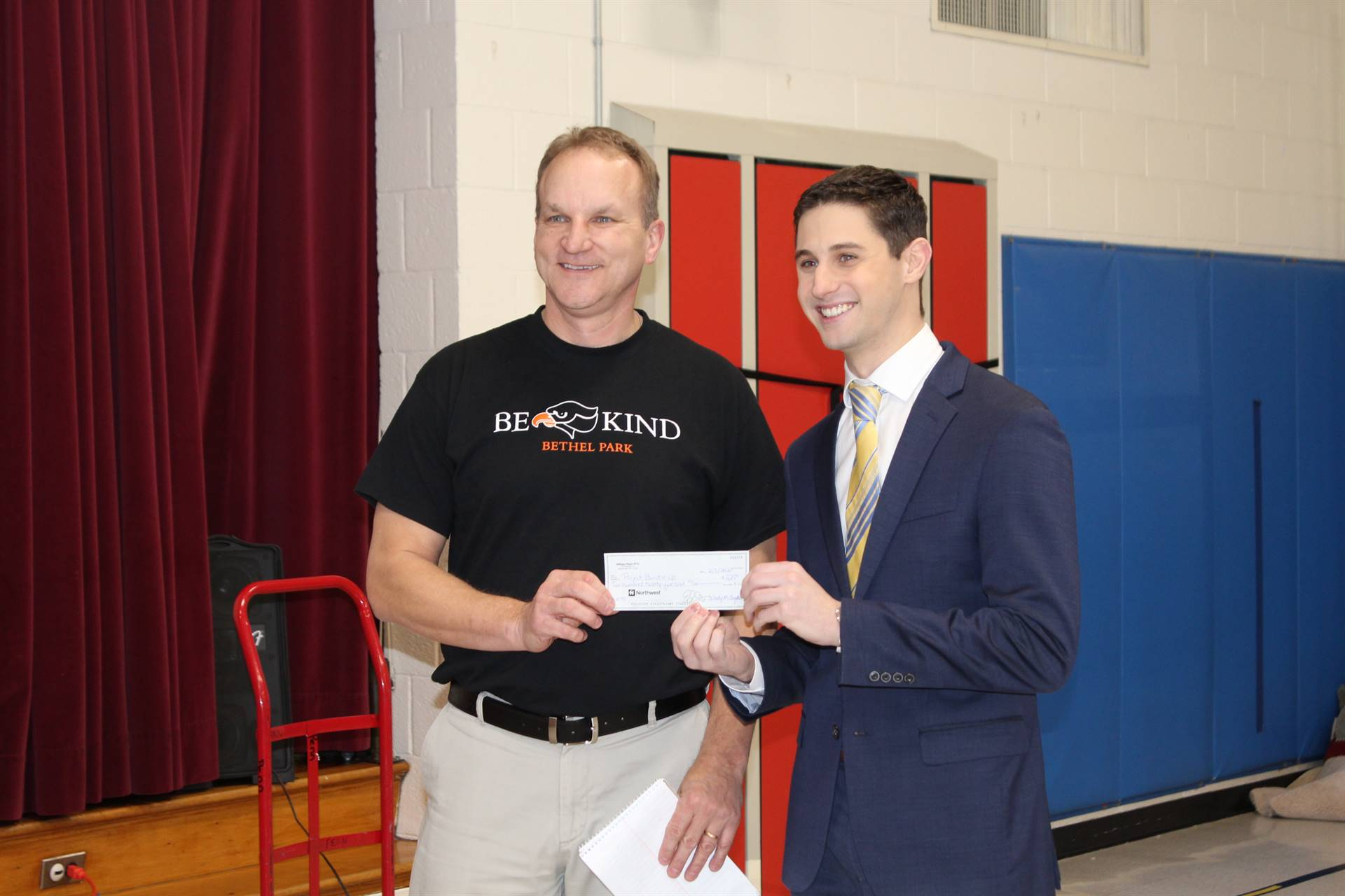 Mr. Lenosky giving a check to Alex Alecci