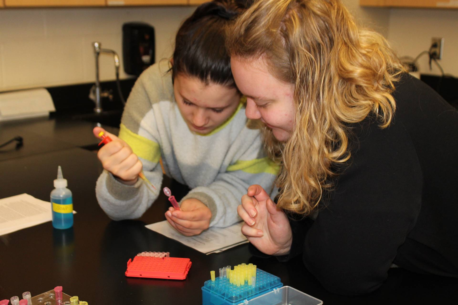 Two students conducting an experiment