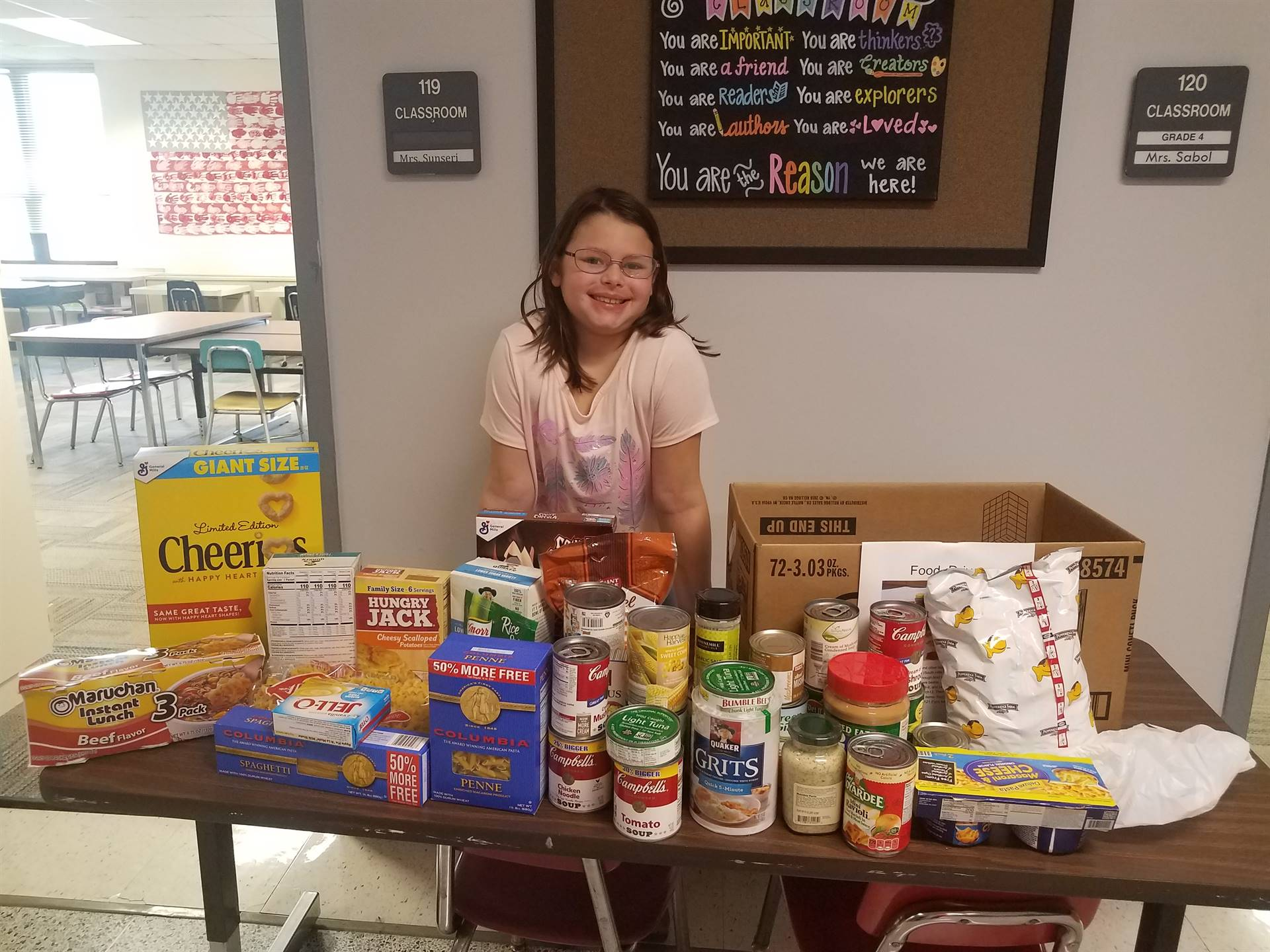 Student with some of the food items she collected for SHIM