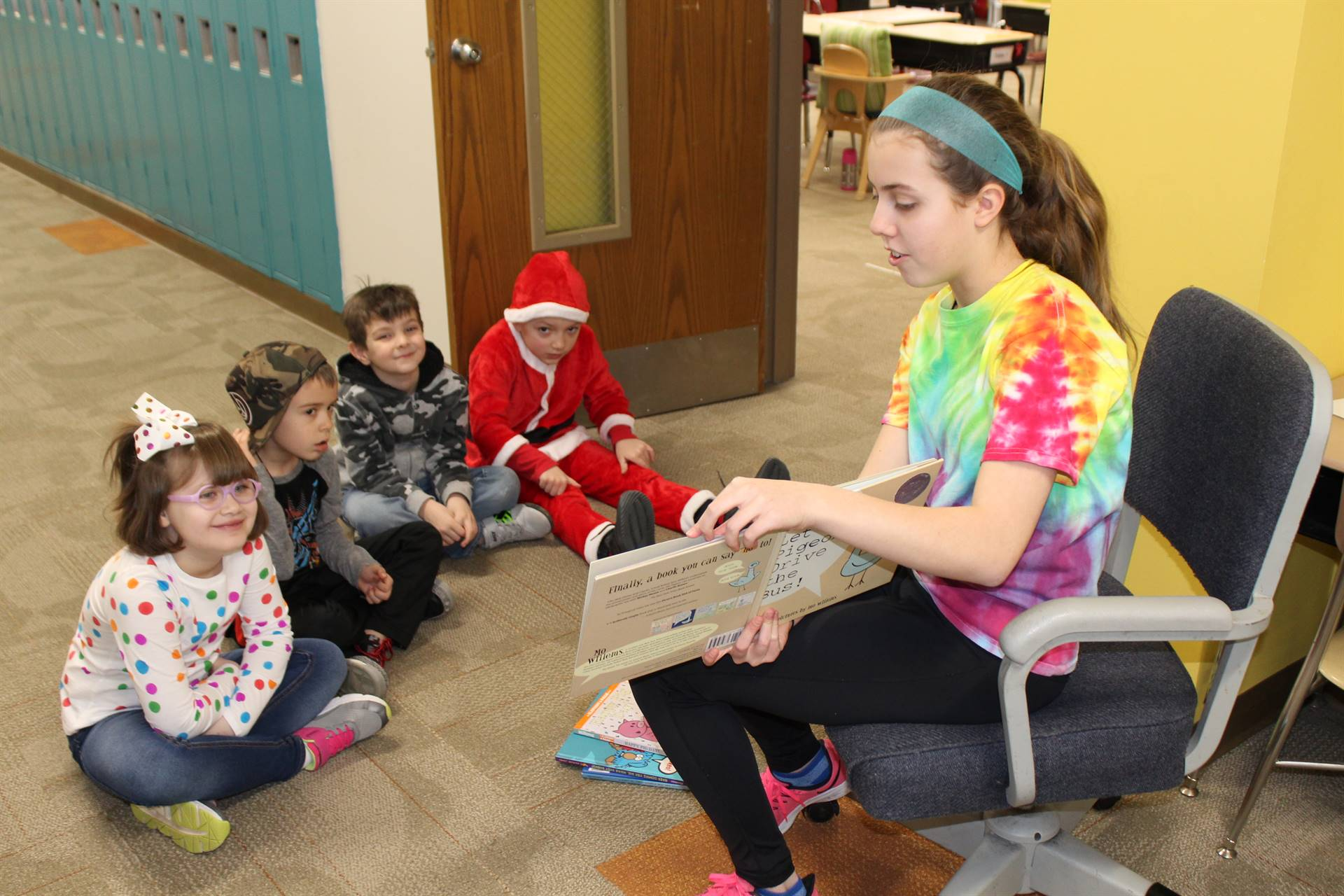 Student reading to group of students