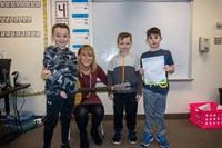 Three students and Miss Thomas