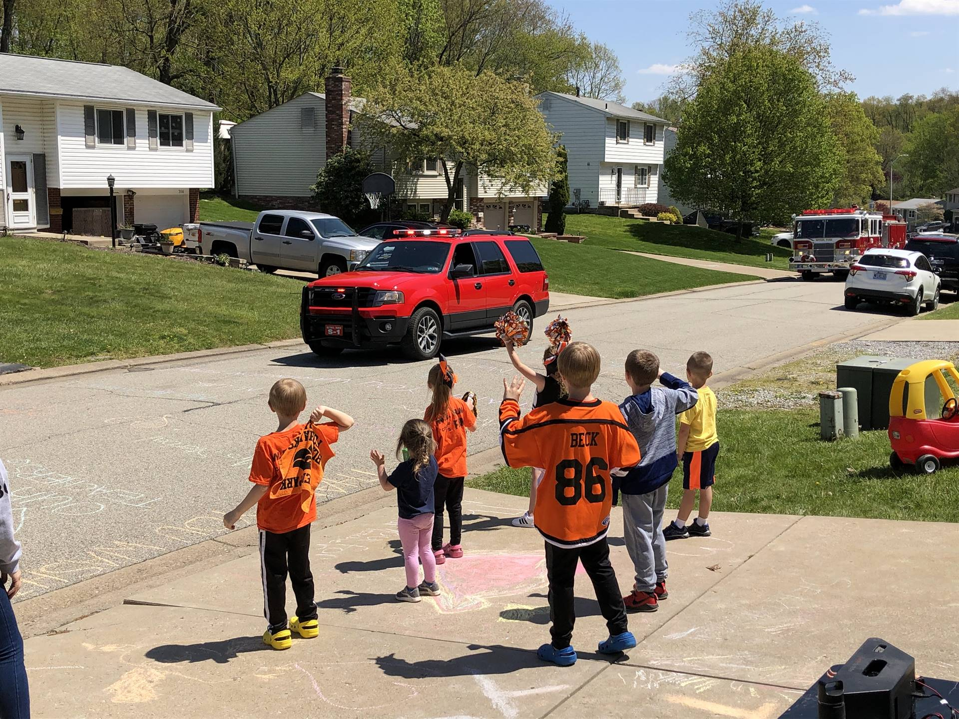 Students waving as the parade passes by