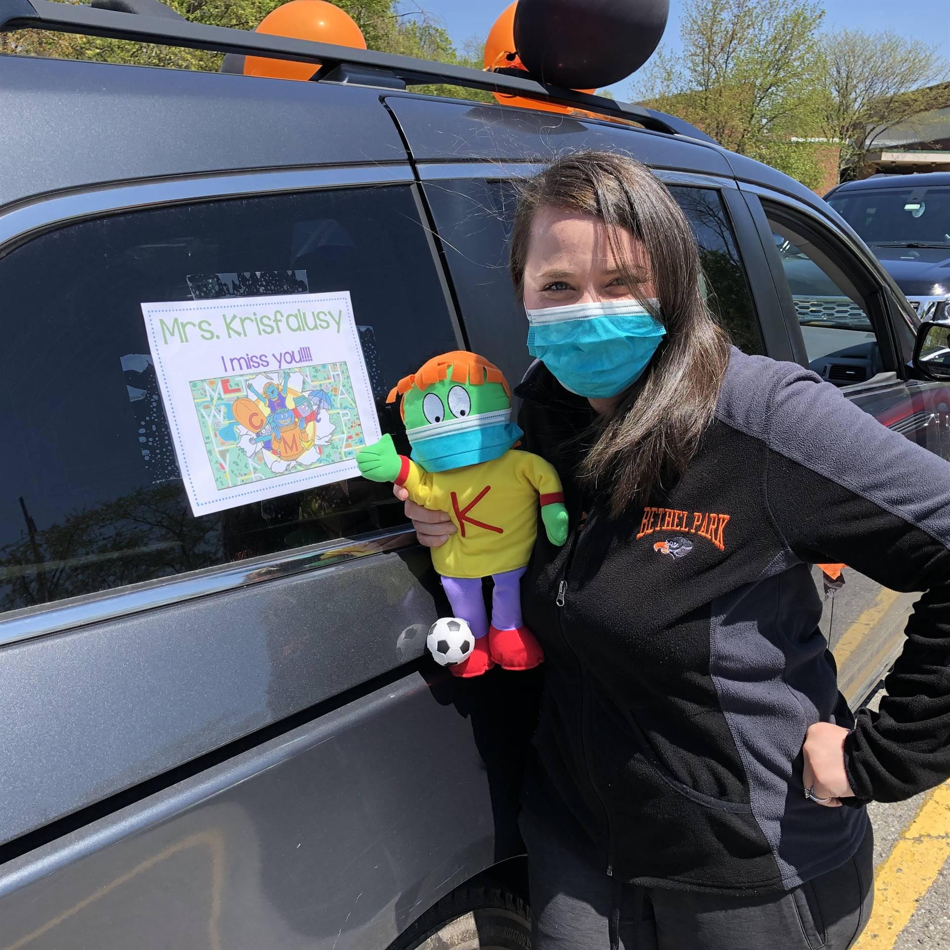 teacher standing by her car