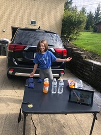Student at the water station