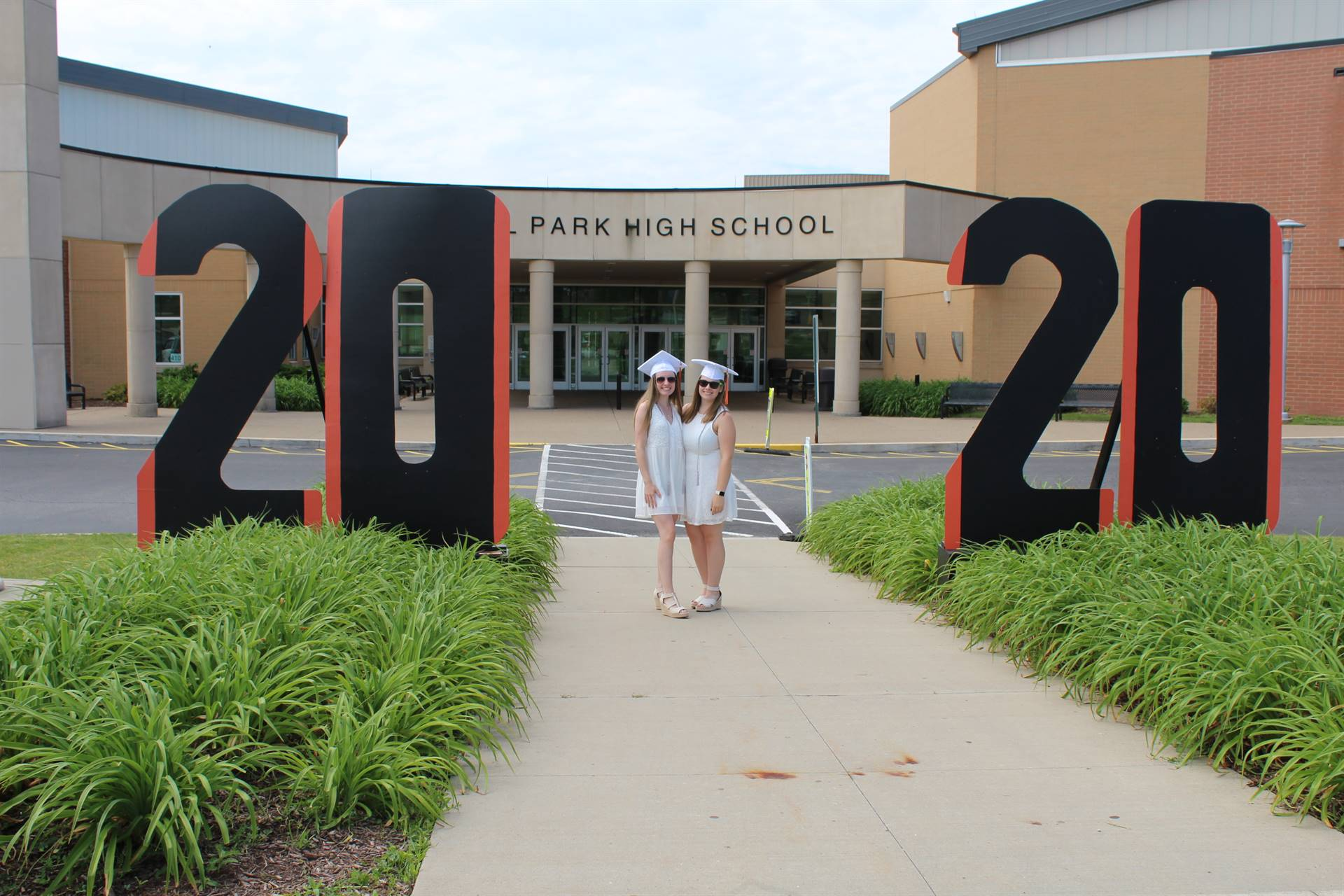 two students by the 2020 sign