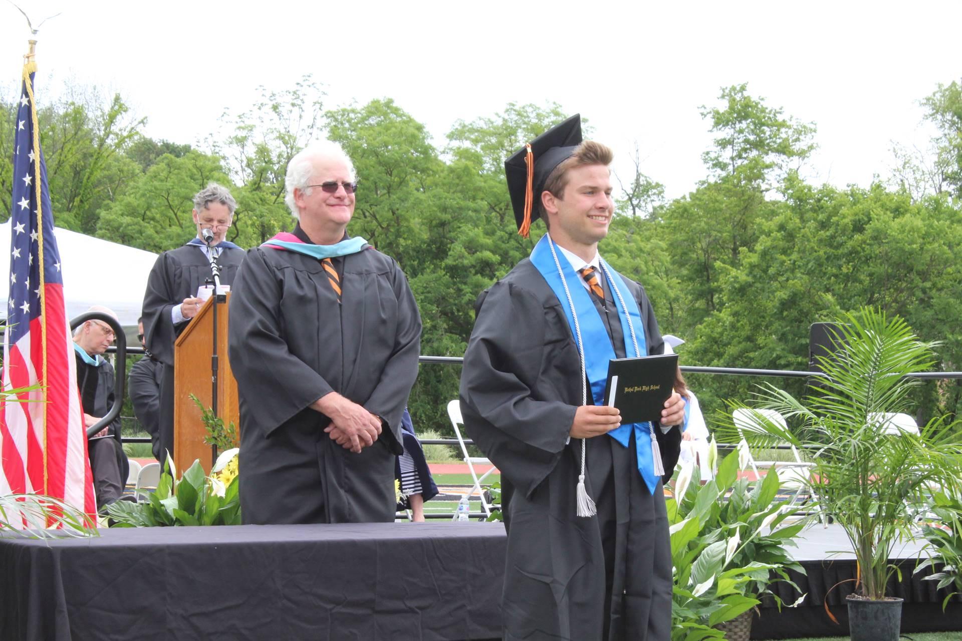 graduate with diploma