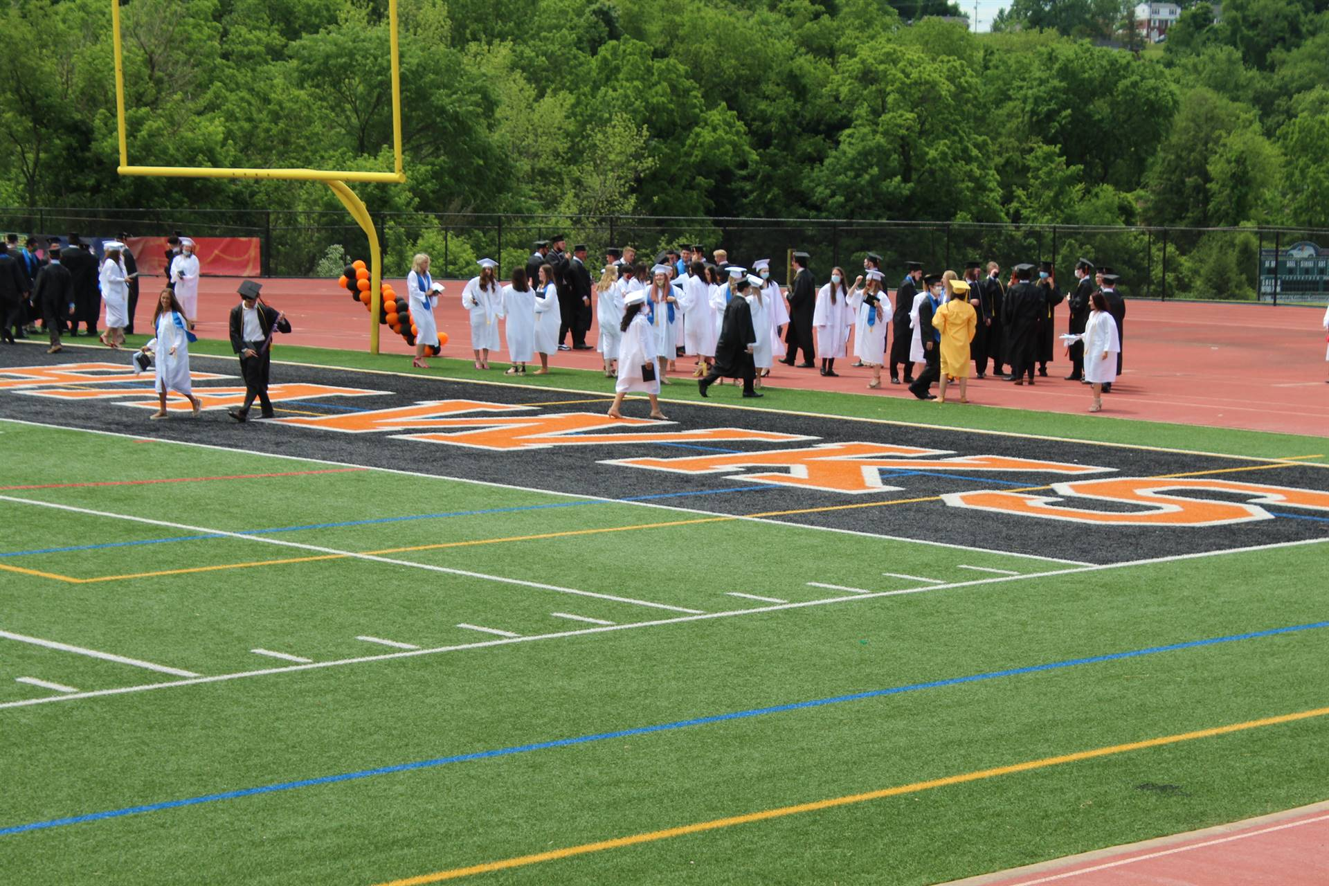 2020 Graduates in the end zone