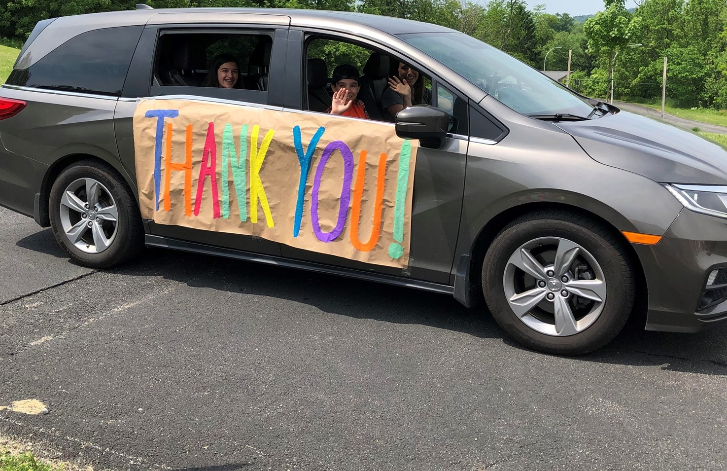 car with a thank you sign on the side