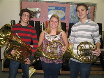 Three students holding horns