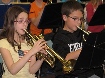 Two students playing trumpets