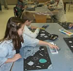 Two students working on an art project